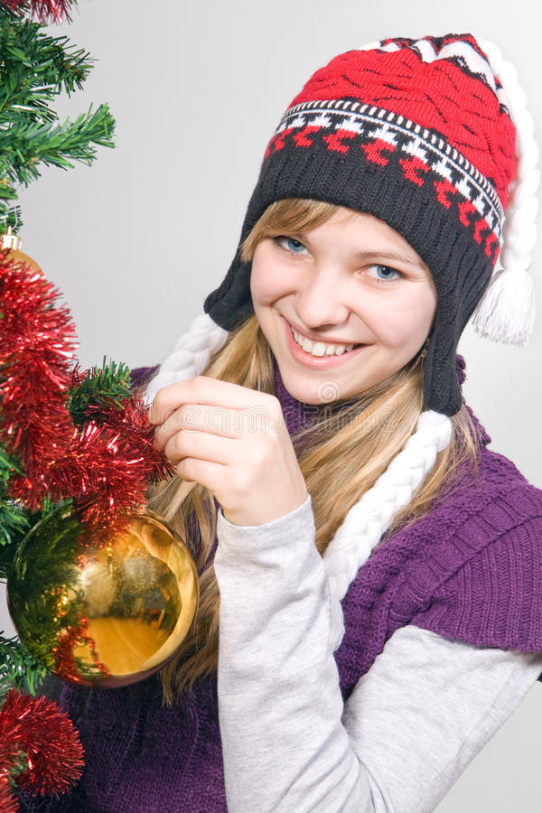 Download Girl Decorate The Christmas Tree Stock Photo - Image: 21469192
