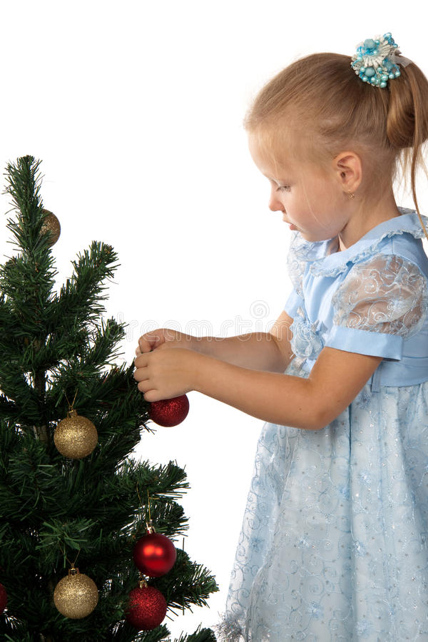 Download Girl Decorates A Christmas Tree Stock Image - Image: 10991649