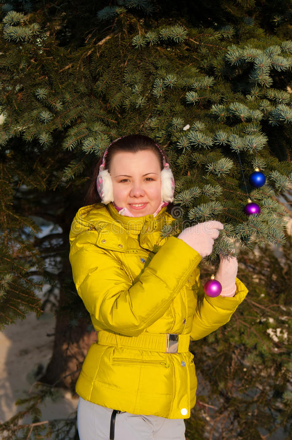 Girl decorating christmas tree stock photography