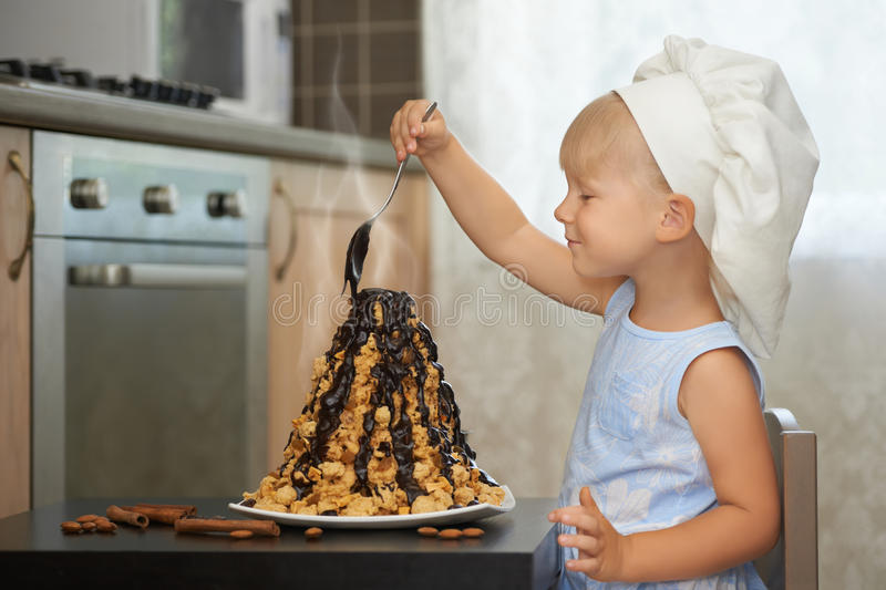Download Girl Decorating A Hot Chocolate Volcanoe Cake Stock Photo - Image of childhood, chef: 96714896