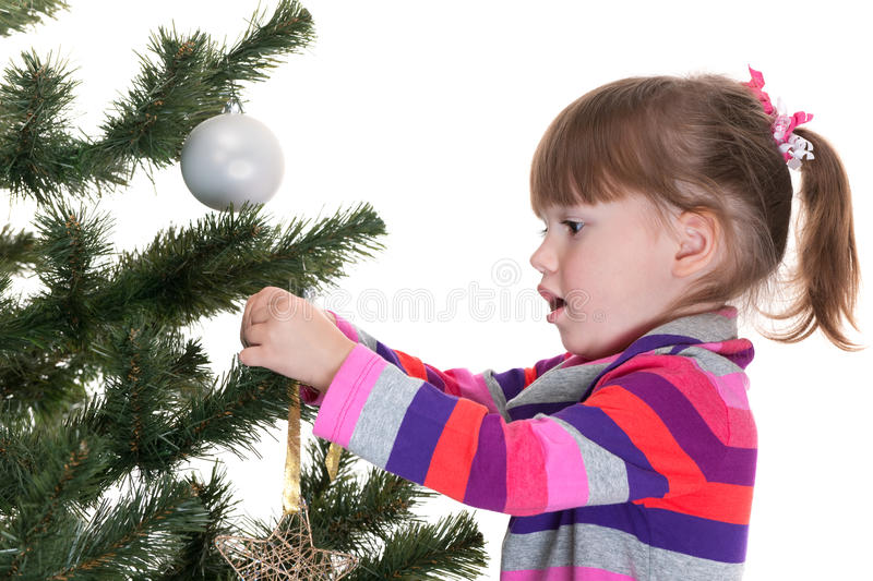 Girl Decorating A New Year Tree Royalty Free Stock Image