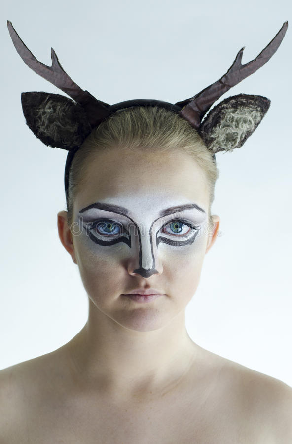 Girl with deer facepaint royalty free stock photos