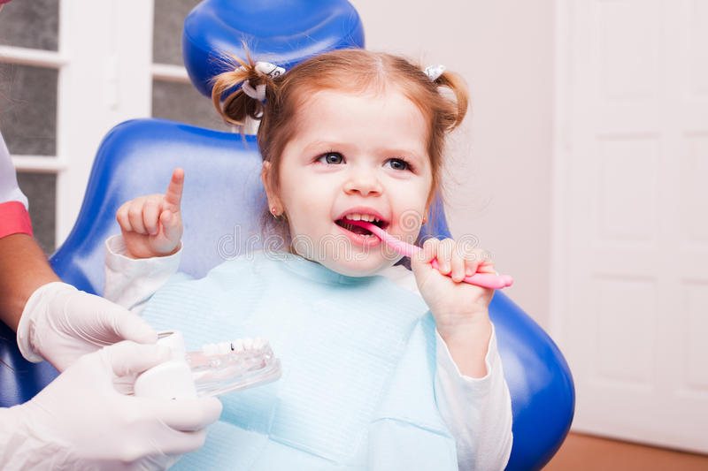 The girl in dental office stock images