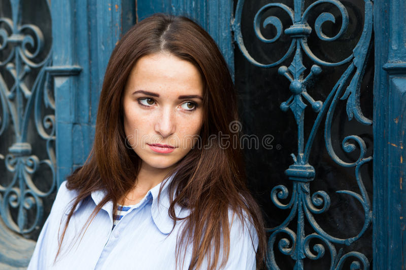 Girl in depression on the blue background. Girl in depression on blue background stock photo