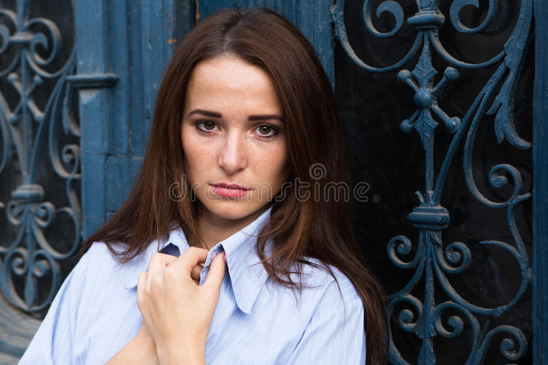 Girl in depression on the blue background. Girl in depression on blue background royalty free stock image