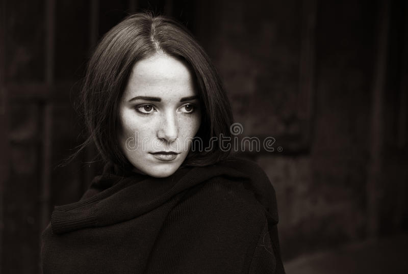 Girl in depression on dark background. Young Girl in depression on dark background royalty free stock image