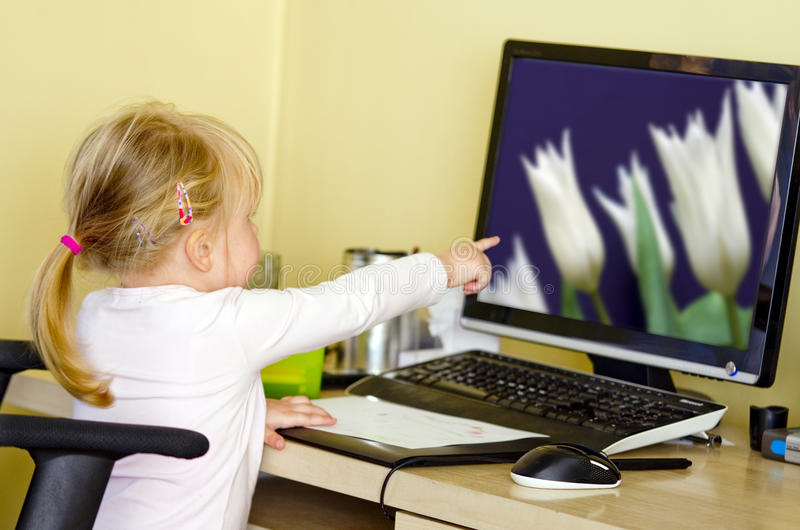 Girl At Desktop Computer Stock Photo