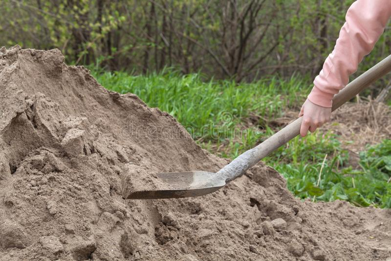 Girl digging sand shovel stock photos