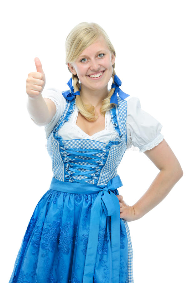 Girl in dirndl holding thumbs up