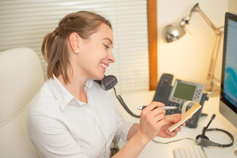 Girl dispatcher works with the phone. In the call center stock image