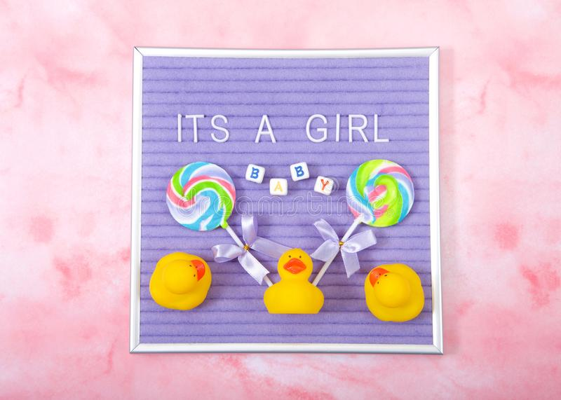 It is a girl display sign on pink marbled background royalty free stock photography