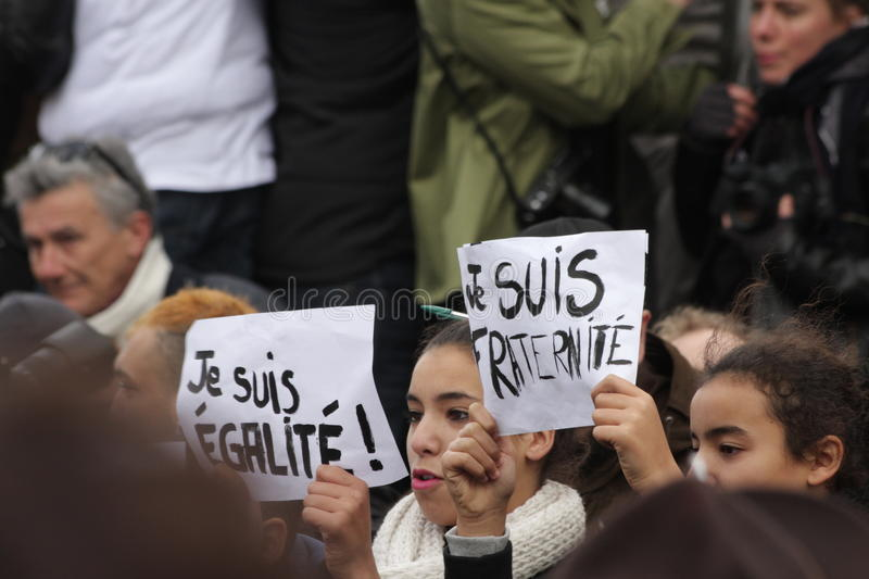 Girl displaying slogans advocating equality and fraternity. During manifestation on Republic Square in Paris against terrorism and in memory of the attack stock image