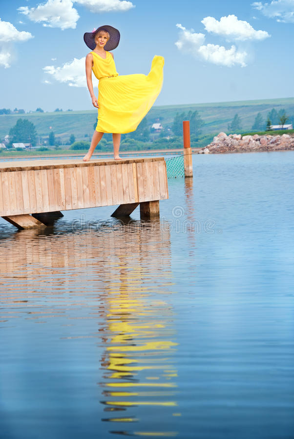 Download A girl  on the dock stock image. Image of carefree, resort - 26039477