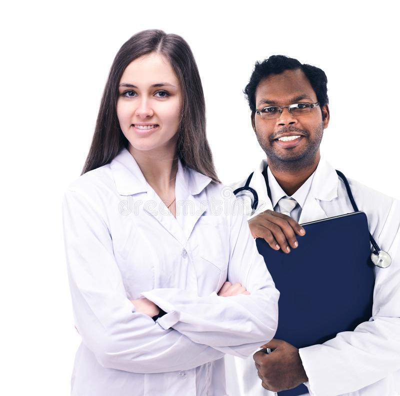 Girl doctor vmese with his assistant smiling and looking into the frame royalty free stock image