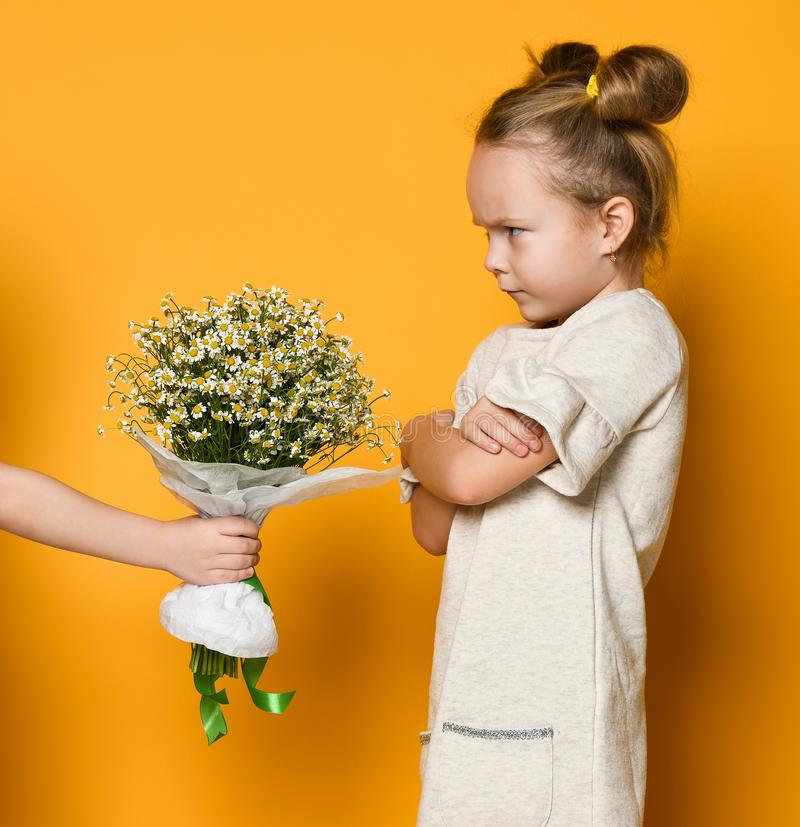 Girl does not want to accept a gift flowers royalty free stock photography