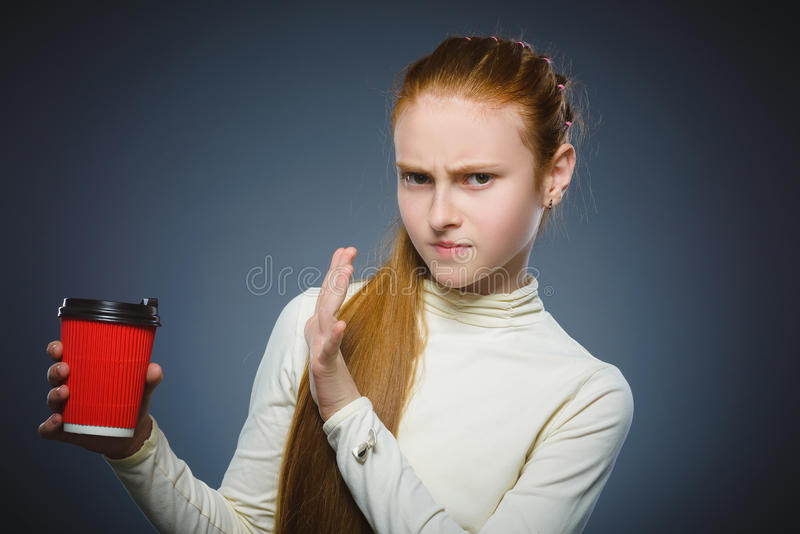 Girl does not want to drink coffee. The child does not like the beverage royalty free stock photo
