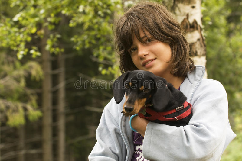 Girl with Dog. Girl in the grass with pet dog royalty free stock images