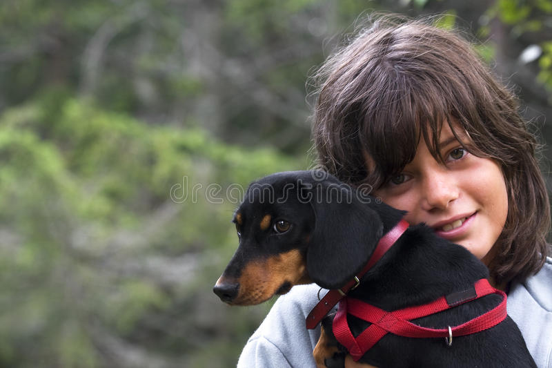 Girl with Dog. Girl in the grass with pet dog stock photos