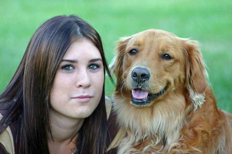 Girl and Dog. Girl looking serious with dog stock image