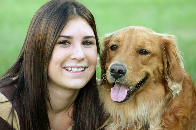 Girl and Dog. Girl smiling with golden retriever stock photo