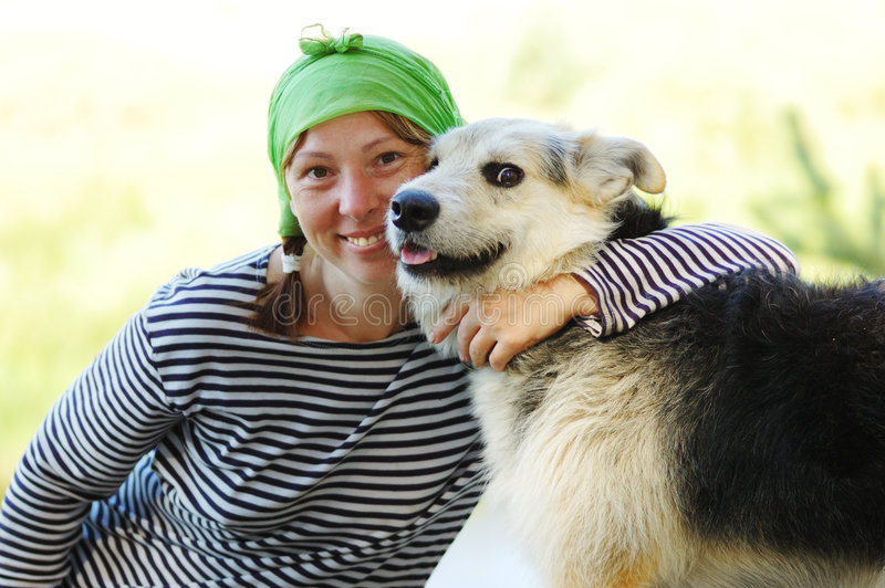 The girl and dog stock image