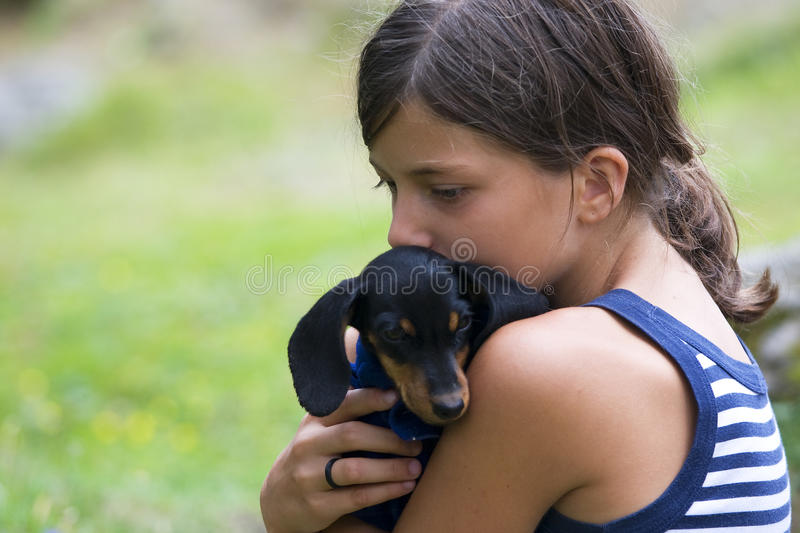 Girl with Dog. Girl in the grass with pet dog stock image