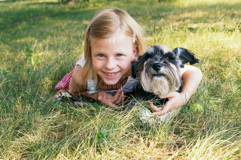 Girl and a dog. Cute little girl with a dog in the park stock images