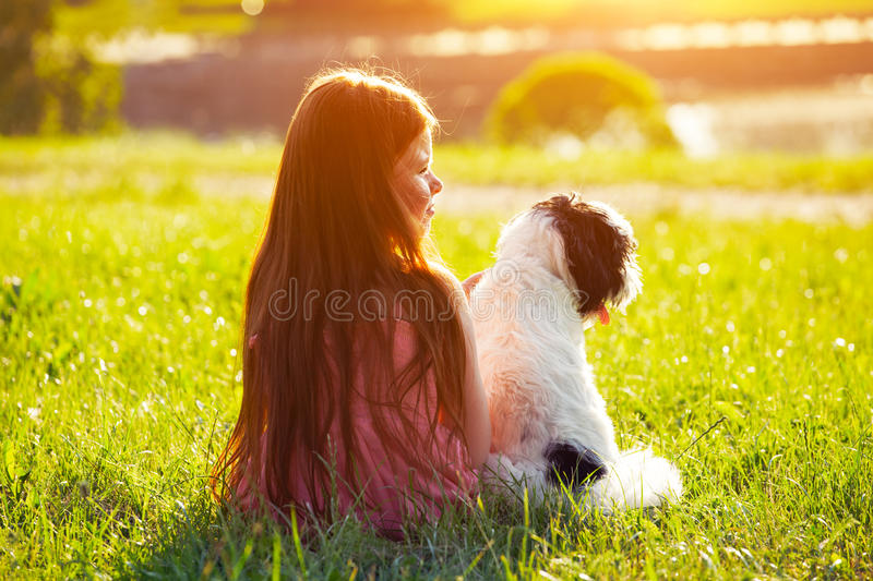 Girl with dog. Friendship concept stock photography