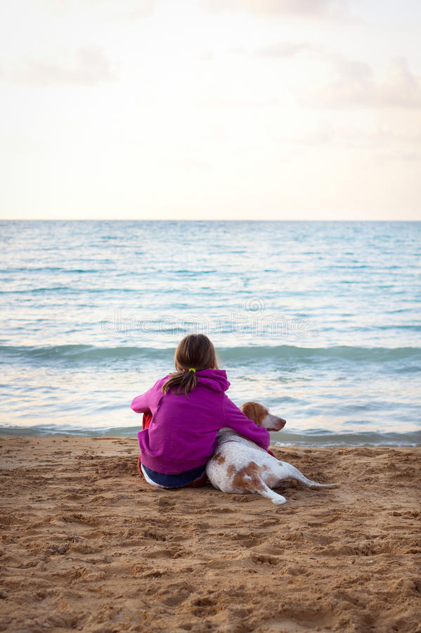 Girl and dog by the ocean stock images