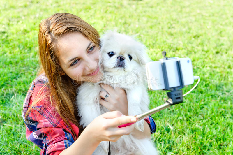 Girl with dog taken pictures of her self, stock photos