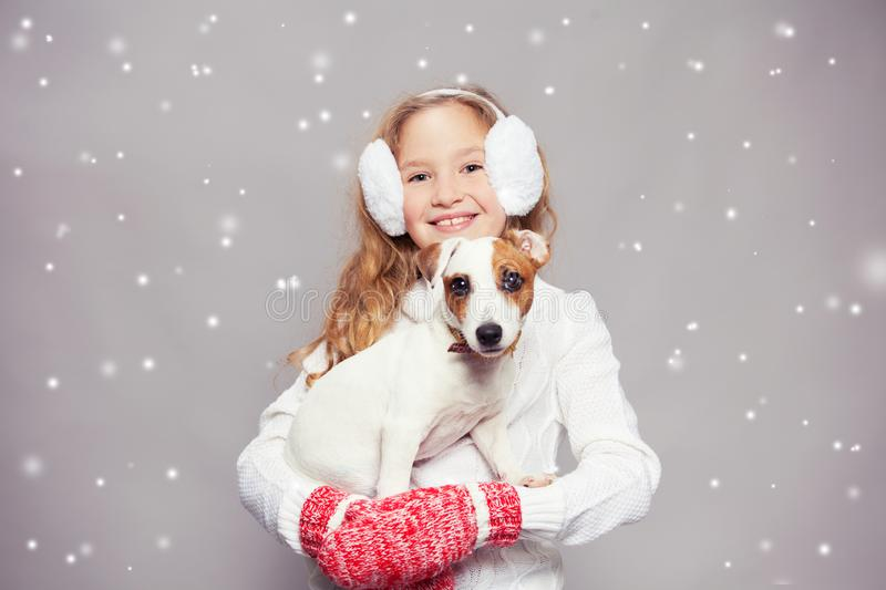 Girl with puppy in winter clothes royalty free stock photos
