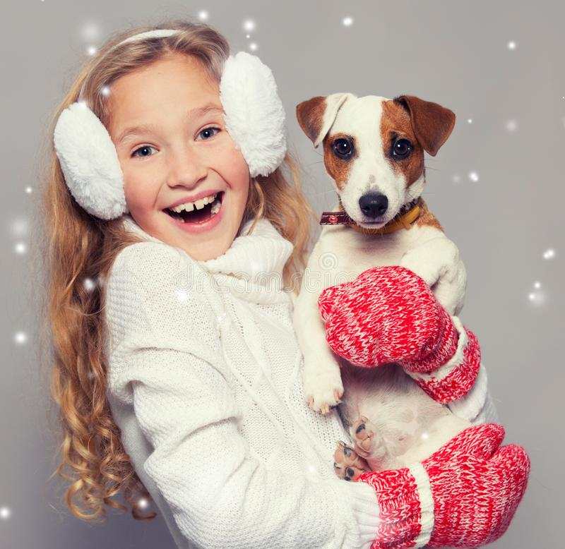 Girl in winter clothes with dog royalty free stock photos