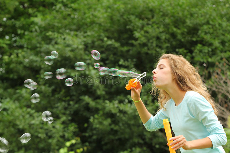 Download Girl doing bubble soap stock image. Image of play, happy - 26015919