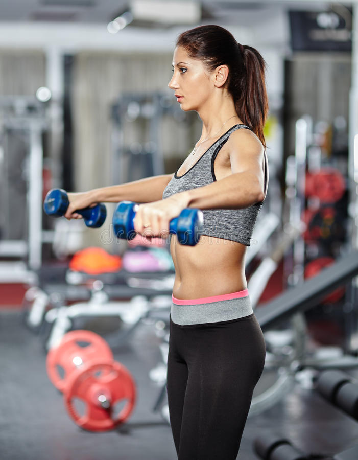 Girl doing deltoid workout stock image. Image of activity - 48602625