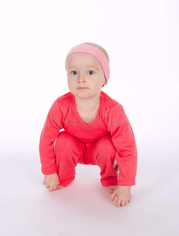 Girl doing exercice on white background. Cute little girl doing exercice on white background royalty free stock image