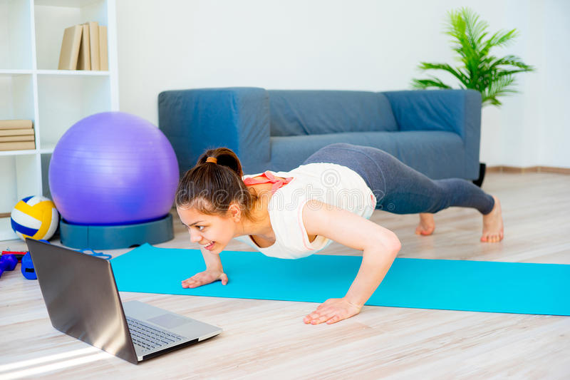 Girl is doing fitness at home stock images