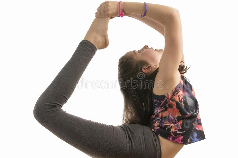 Girl doing gymnastics in a studio royalty free stock photography