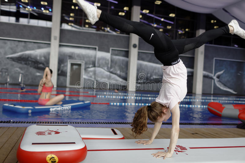 Download Girl Doing Handstand On A Fitness Raft Editorial Stock Photo - Image: 93287178