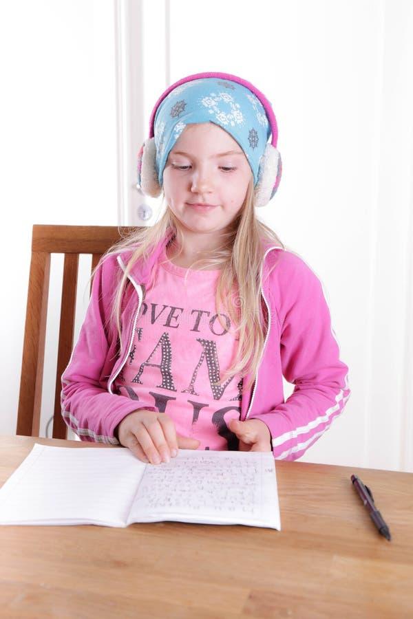 Girl doing her homework stock photos
