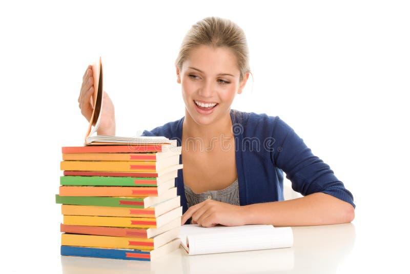 Girl doing homework stock photography