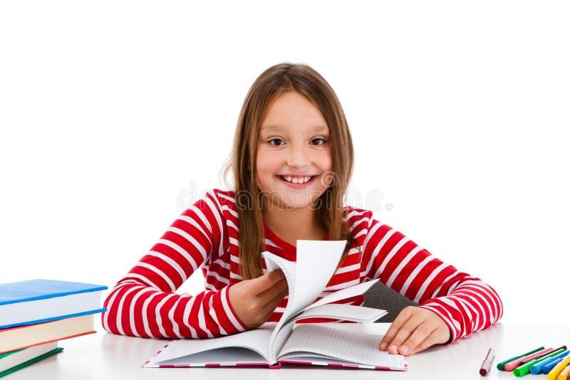 Girl Doing Homework Isolated On White Background Royalty Free Stock Photo