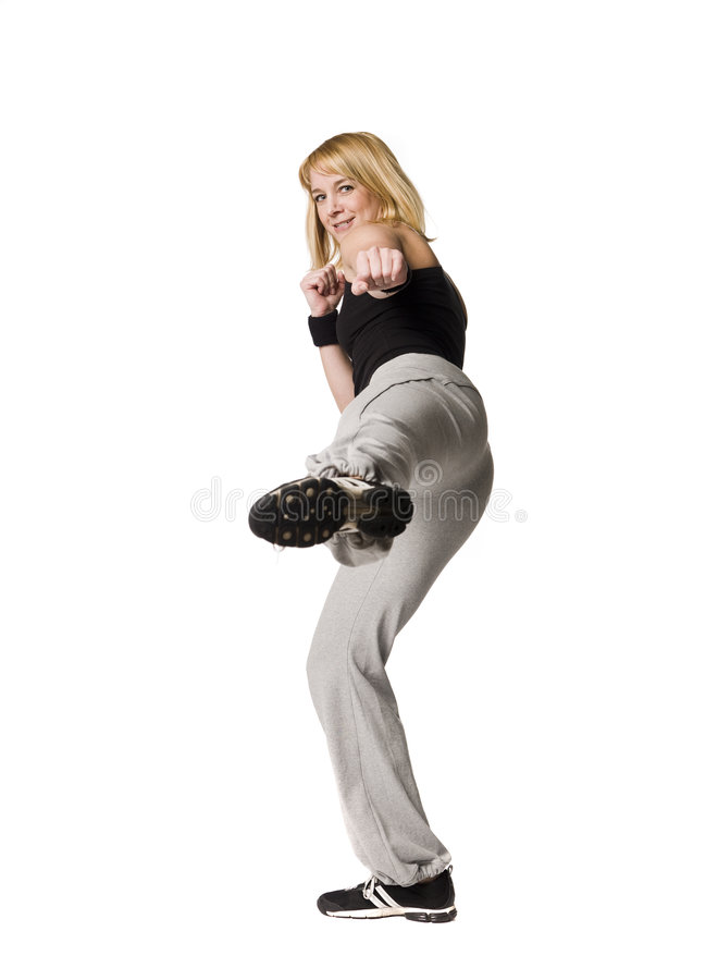 Girl Doing A Kick Royalty Free Stock Images