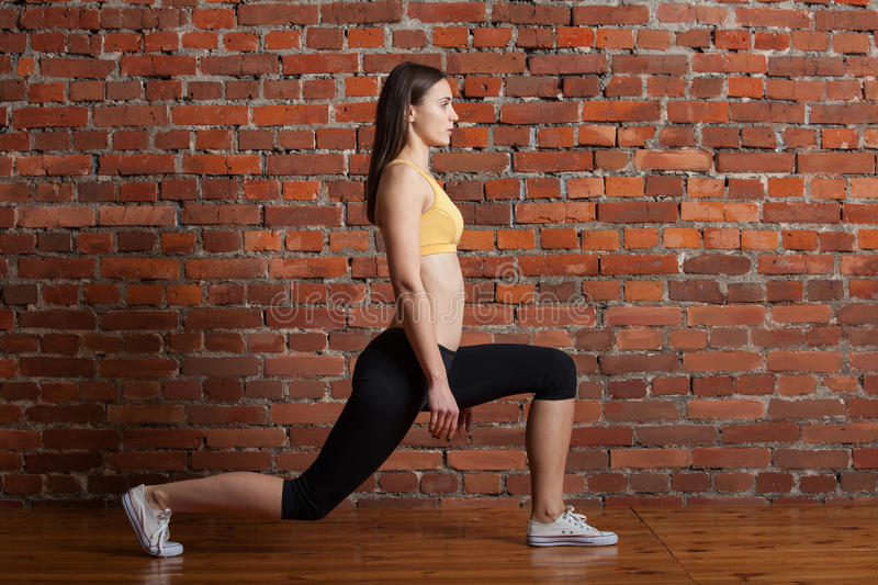 Girl doing a lunge royalty free stock photography