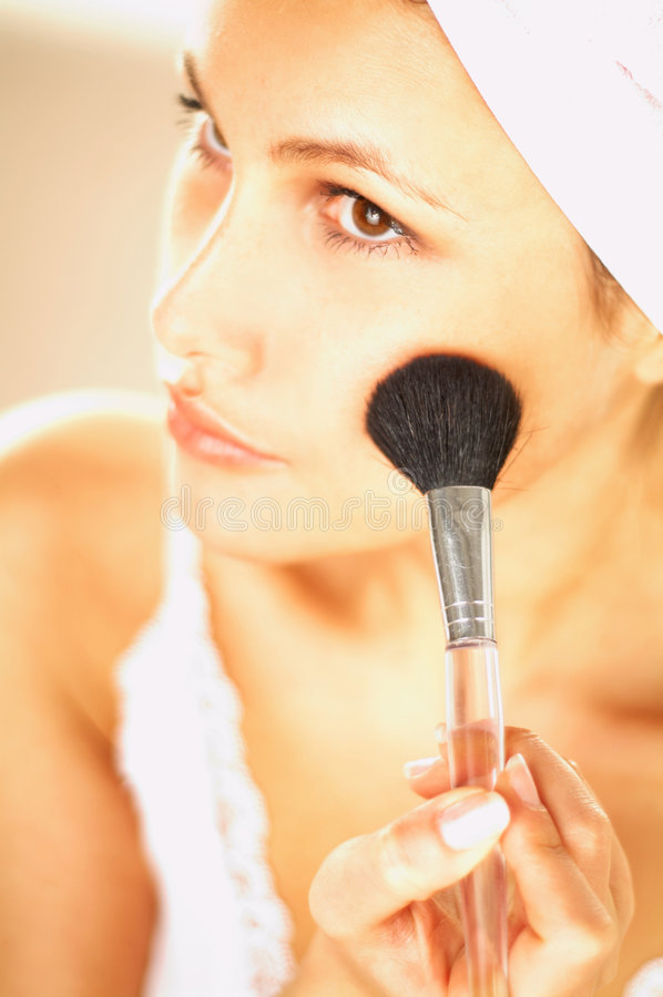 Girl doing makeup. Close up royalty free stock photo