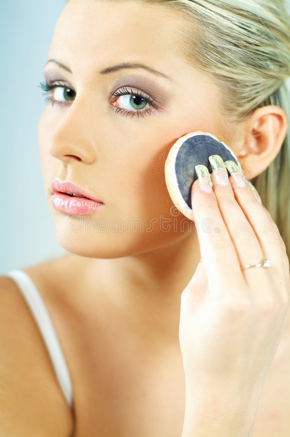 Girl doing makeup royalty free stock images