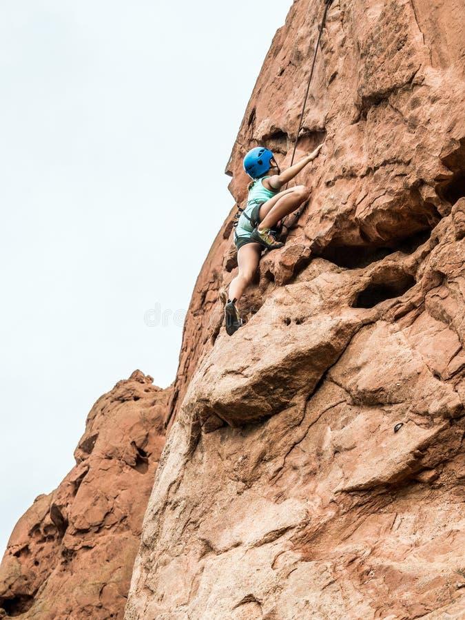 A girl doing rock climbing stock photo