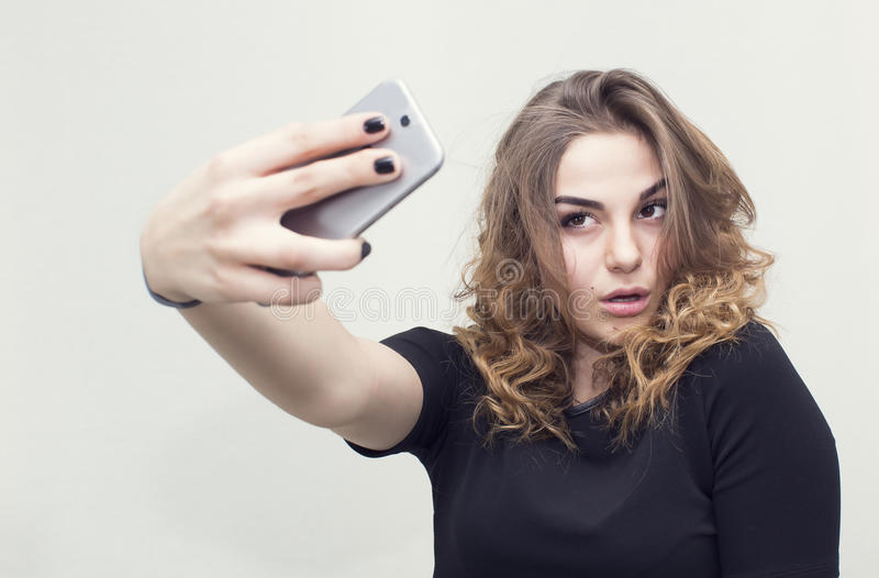 Girl doing self phone stock photo