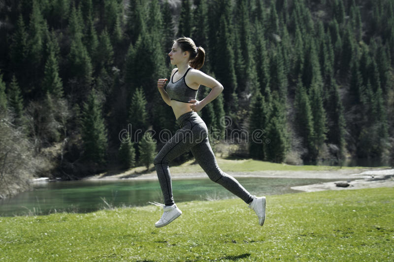 A girl doing sports in the mountains stock image