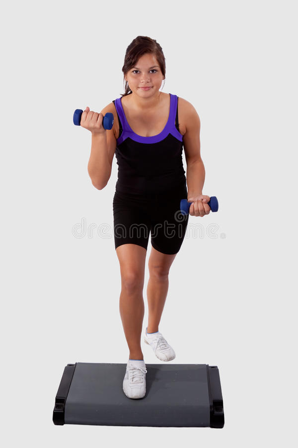Girl doing step aerobics royalty free stock image
