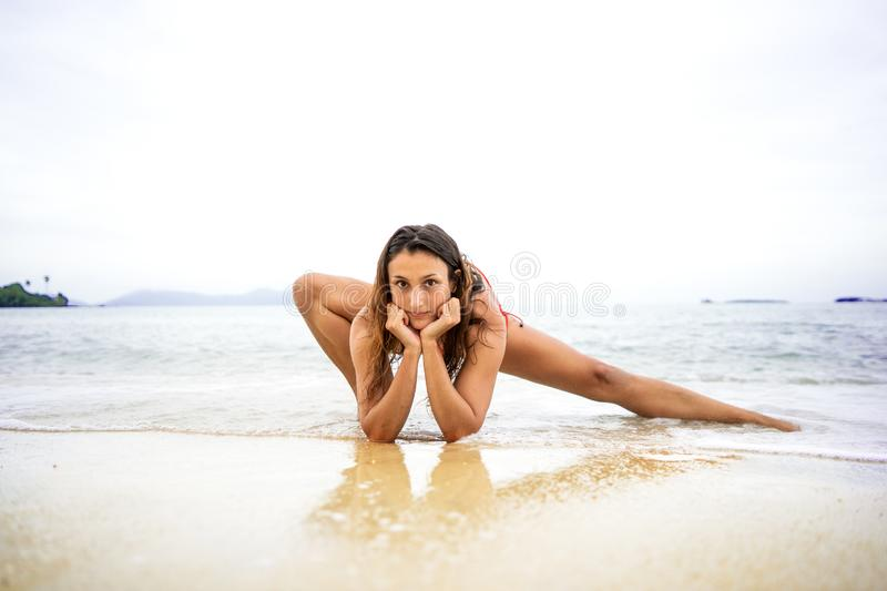 Girl doing yoga on the beach royalty free stock photos